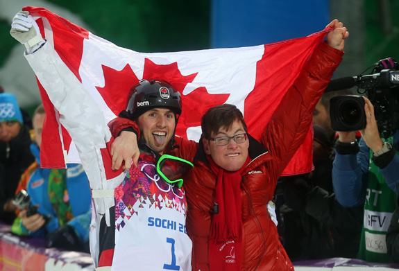 Alex Bilodeau celebrated Monday after winning gold in the men's freestyle skiing moguls at the Sochi Olympics with his brother Frederic, who has cerebral palsy. (Valery Sharifulin/ITAR-TASS/ZUMAPRESS.com/MCT)