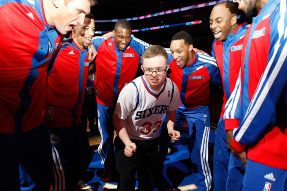 Kevin Grow, who has Down syndrome, joined the Philadelphia 76ers in a pre-game chant. The team signed Grow to a two-day contract this week after video of him playing in a high school game went viral. (Ron Cortes/Philadelphia Inquirer/MCT)