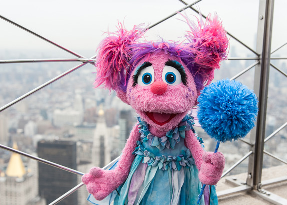 Sesame Street's Abby Cadabby helped light the Empire State Building blue earlier this week in honor of World Autism Awareness Day. The nonprofit behind Sesame Street is launching a new initiative to help educate the public about the developmental disorder. (Gil Vaknin/Sesame Workshop)