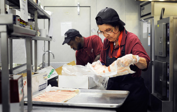 Cindy Iames, right, and Damien Ross make less than minimum wage working at Chimes Cafe in Baltimore. (Christopher T. Assaf/Baltimore Sun/MCT)