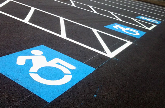 An effort to adopt a more in-motion symbol for accessibility is gaining traction with New York requiring all new signage in the state to utilize the