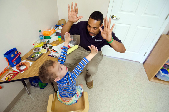 Behavior specialist Lamar Williams conducts a therapy session at an autism center in Prestonsburg, Ky. A new review finds more evidence backing behavioral intervention for kids with autism. (John Flavell/Lexington Herald-Leader/MCT)