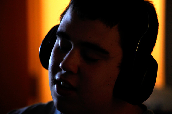 Ido Kedar, who has autism, wears headphones due to his heightened sensitivity to sound. Researchers say that sensory issues among those on the spectrum could be related to impaired prediction abilities. (Genaro Molina/Los Angeles Times/MCT)