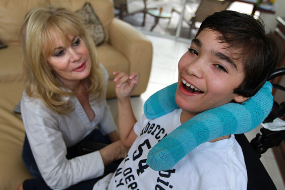 Judy Susser, left, of Boca Raton, Fla, with her son Adam, who has cerebral palsy. A new study suggests that adolescents with cerebral palsy have a quality of life comparable to their peers without the condition. (Carline Jean/Sun Sentinel/MCT)