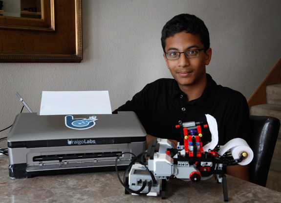 Shubham Banerjee poses with the Braille printer he built out of Legos and a prototype of a Braille printer, left, that he hopes to get manufactured. (Patrick Tehan/Bay Area News Group/MCT)