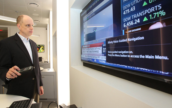Tom Wlodkowski, a Comcast Corp. executive who is blind, demonstrates new features the company is rolling out designed to make television more accessible for people with disabilities. (Charles Fox/Philadelphia Inquirer/TNS)