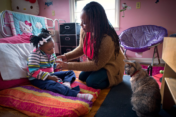 Angela McWilliams gives her daughter Millie, 9, a nutrition drink at their home in Kansas City, Mo. A new genetic test has made it possible to diagnose a rare developmental disorder that affects Millie. (Keith Myers/The Kansas City Star/TNS)