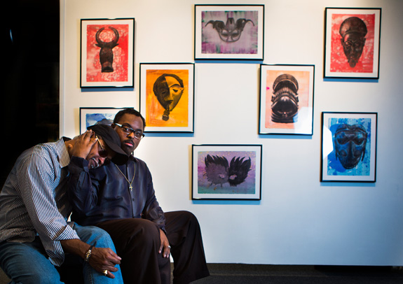 Ezra Roy, 26, holds Alvin Roy, who not only has been his parent but also his art teacher and mutual source of inspiration. Ezra graduated from Texas Southern University with honors over the weekend, earning a bachelor's degree in arts. His work has been exhibited at the Museum of Fine Arts Houston and at Houston City Hall. (Marie D. De Jesus/Houston Chronicle/TNS)