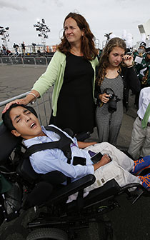 Kristin Keating, center, stands by her son Michael, 10, after Pope Francis stopped to bless him on the airport tarmac in Philadelphia in September. Michael has cerebral palsy and intellectual disabilities. (Charles Fox/Philadelphia Inquirer/TNS)